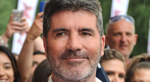 Simon Cowell looked less impressed by an act who chose to present his party piece of sticking spoons to his face