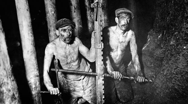 File photo dated 1924 of miners drilling into a coal-face. Britain could see its first full day without generating any electricity from coal on Friday, National Grid has said.