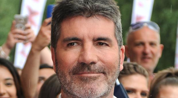 Cowell admitted he had bought a baseball bat to protect his family