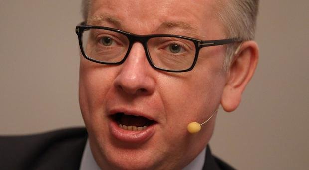 Michael Gove said Theresa May needs a free hand over the economy after the party's 2015 manifesto 'tax lock' pledge