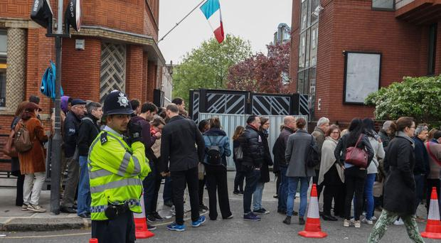 French citizens queue to vote at a polling station in Kensington, London.