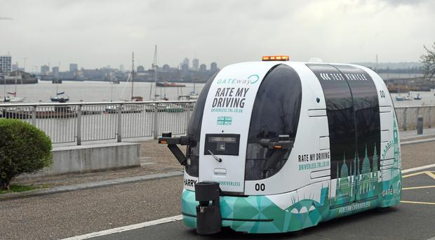 Dozens of people travelled in a prototype shuttle on a two-mile route near London's O2 Arena