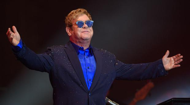 Sir Elton John became violently ill on the flight home from his tour of South America