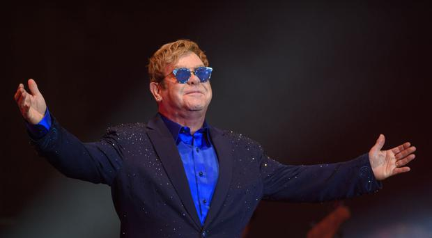 Sir Elton John became violently ill on the flight home from his tour of South America.
