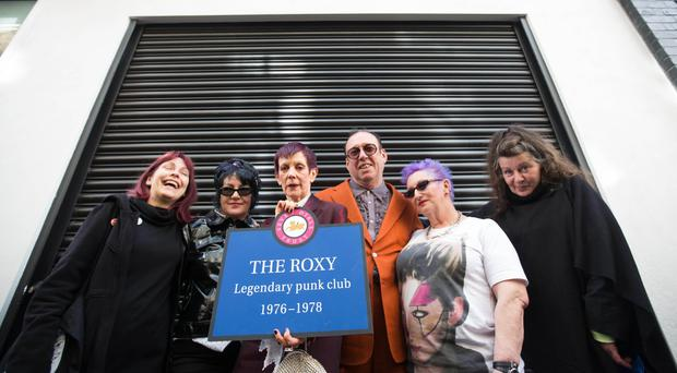 Gaye Black of The Adverts, Pauline Murray of Penetration, Suzanne Carrington and Andrew Czezowski (former owners), Jordan Mooney and Tessa Pollitt of The Slits outside the building that housed The Roxy
