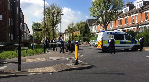 A police cordon in place near the address in Stapleton Hall Road, north-east London (@ppixton/PA)