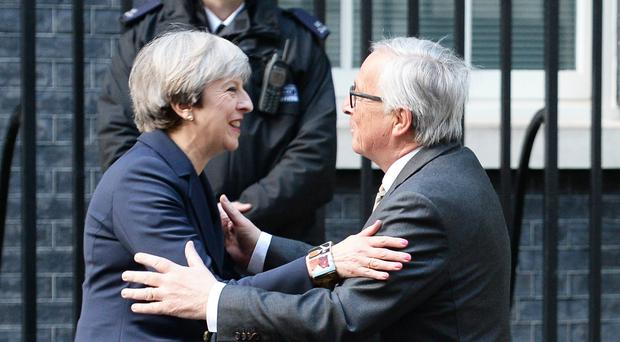 Prime Minister Theresa May greets European Commission President Jean-Claude Juncker (John Stillwell/PA)