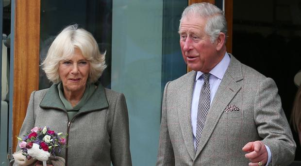 The Prince of Wales and the Duchess of Cornwall, leave menswear shop Wilkies, in Ballater (Andrew Milligan/PA)