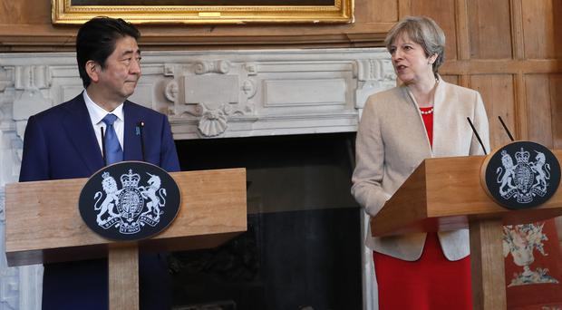 Prime Minister Theresa May speaks during a joint press conference with Japan's Prime Minister Shinzo Abe