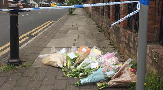 Floral tributes left at the scene in Chorlton, Manchester (PA)
