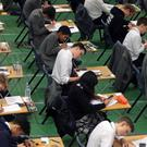 Students sitting an exam (Gareth Fuller/PA)