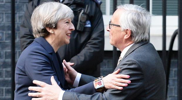 Prime Minister Theresa May greets European Commission President Jean-Claude Juncker ahead of a working dinner at 10 Downing Street, London ( John Stillwell/PA)