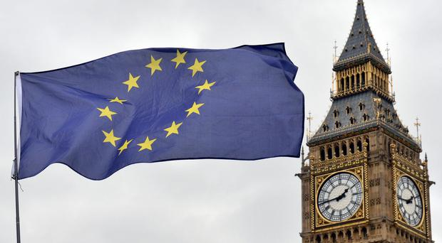 An EU flag flying in front of the Houses of Parliament