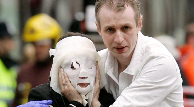 Paul Dadge helping a victim of the 7/7 bombings