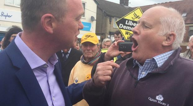 Pensioner Malcolm Baker confronts Liberal Democrat leader Tim Farron while he was the election campaign trail in Kidlington, near Oxford (Sam Lister/PA)