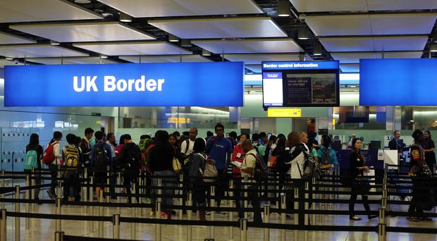 Passengers going through border controls at Heathrow Airport