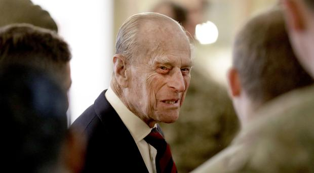 The Duke of Edinburgh, in his capacity of Colonel, Grenadier Guards, talks to Sergeants from 1st Battalion Grenadier Guards in their Mess at Lille Barracks in Aldershot (Matt Dunham/PA)