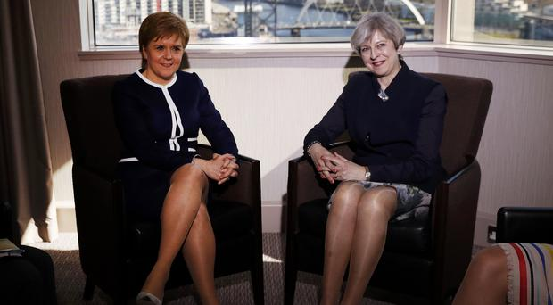 Prime Minister Theresa May (right) and First Minister Nicola Sturgeon (Russell Cheyne/PA)