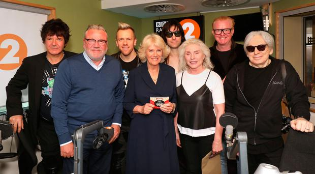 Above: Clem Burke, Ray Winstone, Debbie Harry from Blondie with band members and Chris Evans pose with Camilla, Duchess of Cornwall as she joins the '500 Words' judging panel at BBC Radio 2 Studios yesterday in London