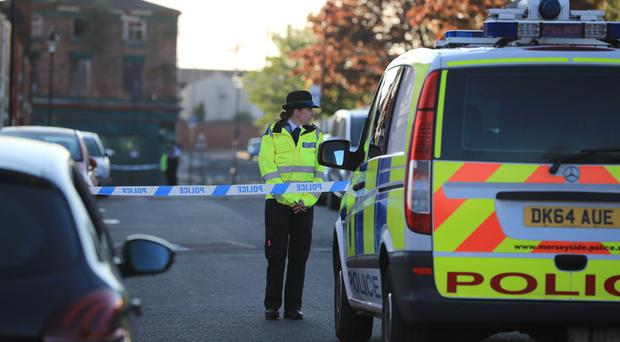 Police close the road in Cockburn Street in Toxteth, Liverpool (Peter Byrne/PA)