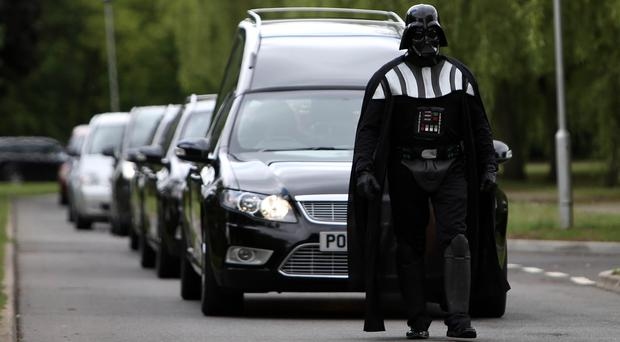 Darth Vader leading the funeral cortege at a Halloween-themed funeral (Steve Parsons/PA)