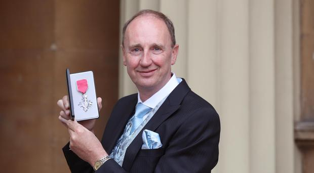 Jonathan Agnew after he was awarded an MBE by the Duke of Cambridge during an Investiture ceremony at Buckingham Palace, London (Jonathan Brady/PA)