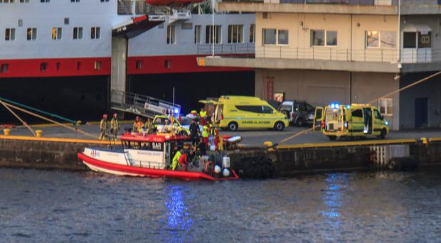 Emergency personnel deal with the aftermath of a helicopter plunging off a superyacht in Bergen, Norway, in which left one Briton critically ill (Jan Haugland/PA)