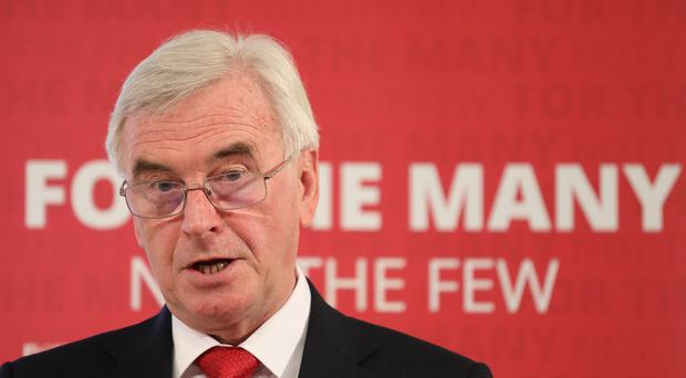 John McDonnell addresses a press conference in London to outline the Tories' threats to living standards which he said would hit pensioners and working people (Philip Toscano/PA)