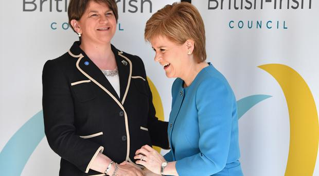 Arlene Foster and Nicola Sturgeon. (Jeff J Mitchell/PA)