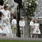 Pippa Middleton and James Matthews leave St Mark's church with their attendants (Kirsty Wigglesworth/PA)