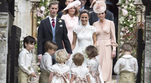 Pippa Middleton walks down the aisle; British royals attend lavish wedding