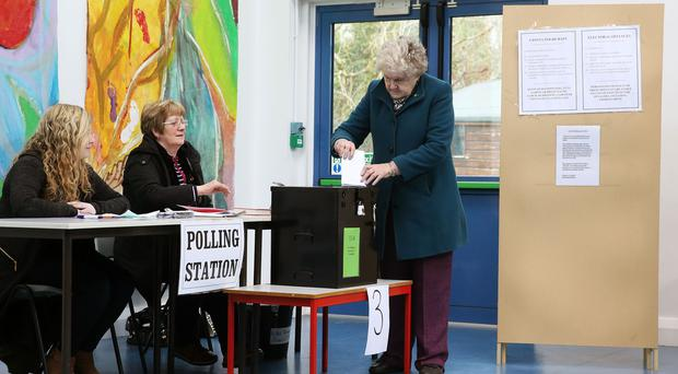 A woman votes (Brian Lawless/PA)
