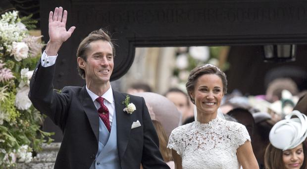 Pippa Middleton and her husband James Matthews leave St Mark's church in Englefield, Berkshire, following their wedding (Arthur Edwards/The Sun/PA)