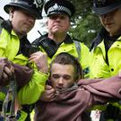 A man is arrested after protesting against fox hunting as Theresa May arrives at the Welsh Conservative manifesto launch in Wrexham (Stefan Rousseau/PA)