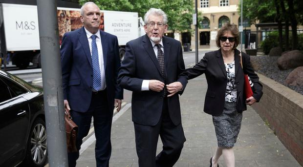 Harris (centre) arrives at Southwark Crown Court with niece Jenny Harris