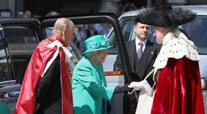 Queen Elizabeth II and the Duke of Edinburgh are greeted by the Lord Mayor of London Andrew Parmley as they arrive at St Paul's Cathedral in London for a service to mark the Centenary of the Order of the British Empire (Philip Toscano/PA)
