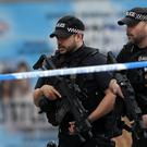 Armed police officers near Manchester Arena (Kirsty Wigglesworth/AP/PA)