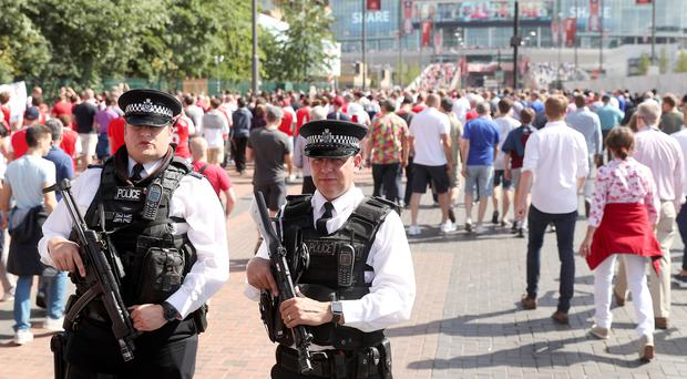 Armed police at Wembley Stadium ahead of the FA Cup final between Arsenal and Chelsea (Adam Davy/PA)
