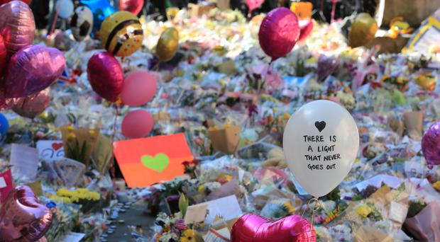 Floral tributes left in St Ann's Square, Manchester ( Peter Byrne/PA)