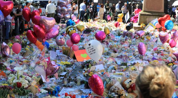 Floral tributes in St Ann's Square, Manchester (Peter Byrne/PA)