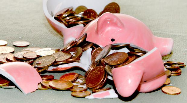 The poll of parents with children aged between four and 16 found three-fifths (60%) of mums and dads admit to dipping into their offsprings' savings (stock photo)