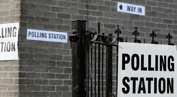 Signs for a a polling station ( Peter Byrne/PA)