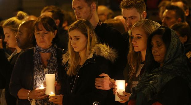 Mourners light candles and pause for a minute's silence in St Ann's Square, Manchester, as they mark the passing of exactly a week since the Manchester Arena terror attack (Jonathan Brady/PA)