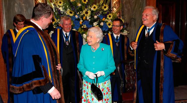 The Queen visits Drapers' Hall for the luncheon yesterday
