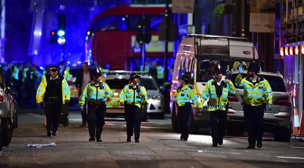 Police officers on Borough High Street after a spate of incidents in the capital (Dominic Lipinski/PA)