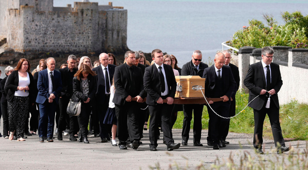 Roddy MacLeod, dad of Manchester bomb victim Eilidh MacLeod leads her funeral procession yesterday
