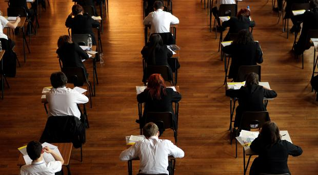 A Belfast high school at the centre of a highly critical report may need outside help after