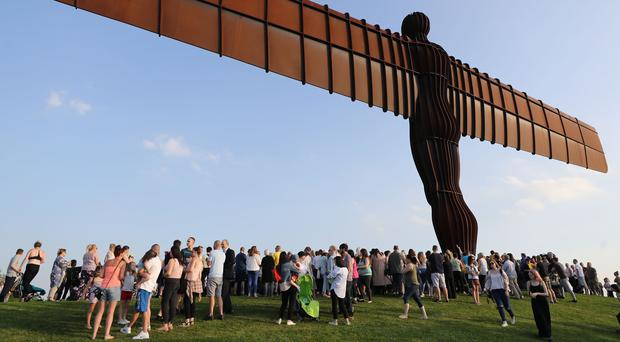 People attend a service at the Angel of the North in Gateshead in memory of Manchester bombing victims Courtney Boyle and stepfather Philip Tron (PA)