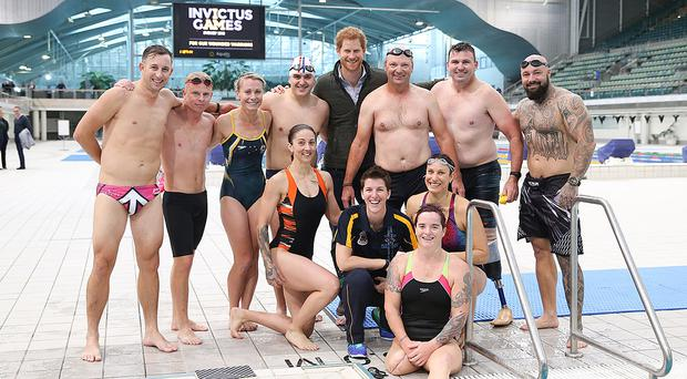 Prince Harry with Team Invictus Australia's training squad members during a visit to the Aquatic Centre at the Olympic Park Sports Centre in Sydney (Invictus Games/PA)