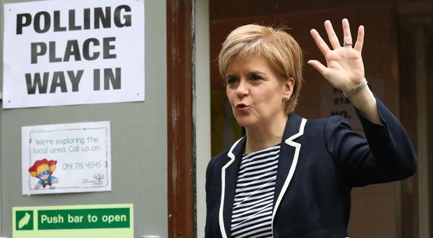 First Minister Nicola Sturgeon arrives to cast her vote in the General Election at a polling station at Broomhouse Community Hall in Glasgow (Andrew Milligan/PA)